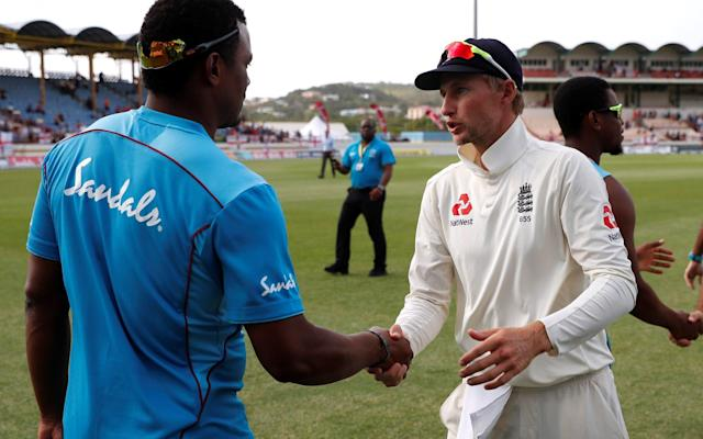 Shannon Gabriel and Joe Root shake hands after the third Test - Action Images via Reuters