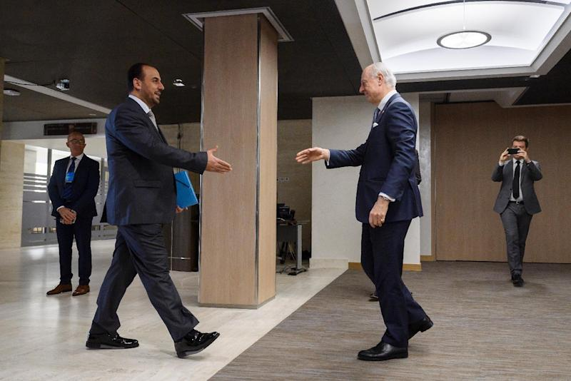 UN Special Envoy for Syria Staffan de Mistura, right, prepares to shake hands with Syria's main opposition High Negotiations Committee, HNC, leader Nasr al-Hariri upon his arrival for a meeting during Syria peace talks in Geneva, Switzerland, Monday,Feb. 27, 2017. (Fabrice Coffrini/Pool Photo via AP)