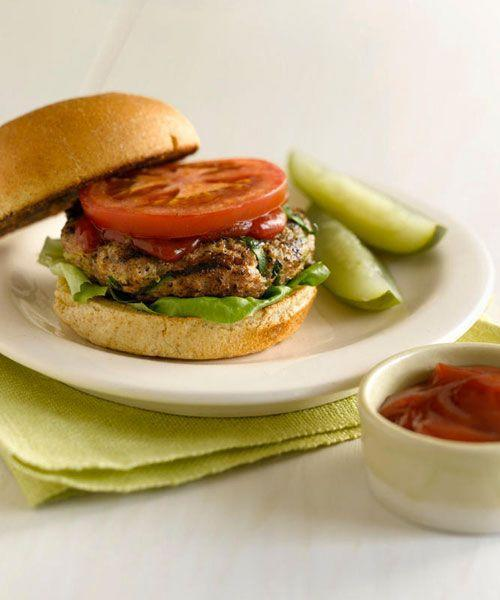 """<p>The grated zucchini and onions in this turkey burger add flavor and moisture, keeping the patty from drying out. Grill or sear on a cast-iron pan.</p><p><strong><a href=""""https://www.countryliving.com/food-drinks/recipes/a17674/grilled-turkey-burgers-recipe/"""" rel=""""nofollow noopener"""" target=""""_blank"""" data-ylk=""""slk:Get the recipe"""" class=""""link rapid-noclick-resp"""">Get the recipe</a>.</strong></p><p><strong><a class=""""link rapid-noclick-resp"""" href=""""https://www.amazon.com/Utopia-Kitchen-Pre-Seasoned-Cast-Skillet/dp/B00X4WQMAS/?tag=syn-yahoo-20&ascsubtag=%5Bartid%7C10050.g.31929300%5Bsrc%7Cyahoo-us"""" rel=""""nofollow noopener"""" target=""""_blank"""" data-ylk=""""slk:SHOP LARGE SKILLETS"""">SHOP LARGE SKILLETS</a><br></strong></p>"""