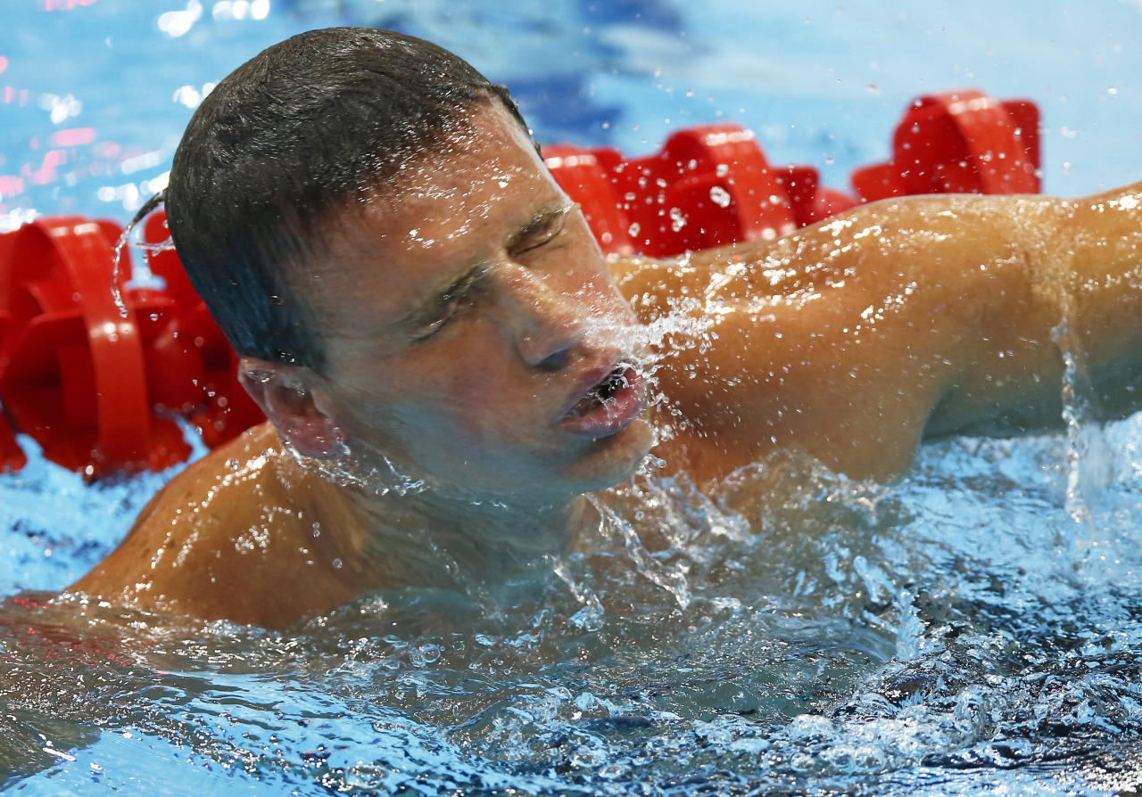 USA's Ryan Lochte competes in a heat of the men's 400-meter individual medley at the Aquatics Centre in the Olympic Park during the 2012 Summer Olympics in London, Saturday, July 28, 2012. (AP Photo/Daniel Ochoa De Olza)