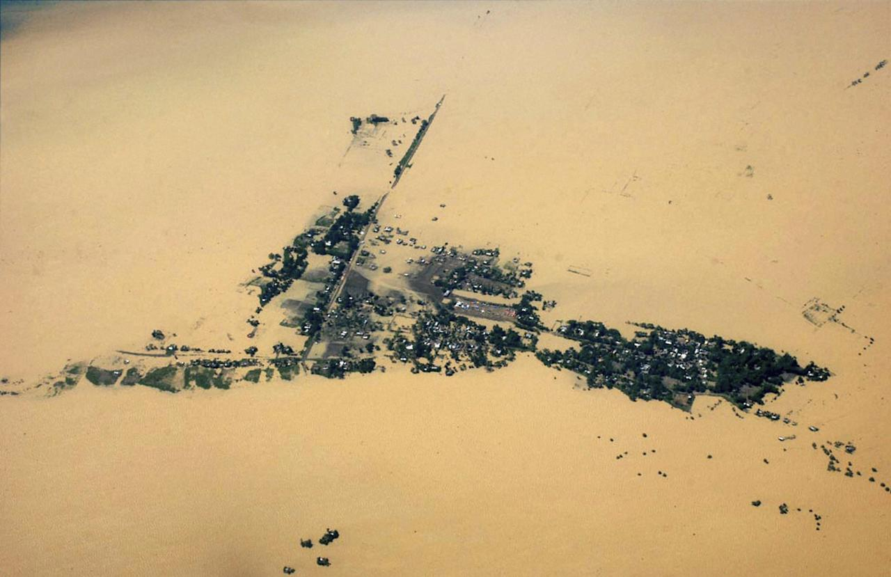 This aerial photo shows a flooded area of Jorhat in Assam state, India, Monday, July 2, 2012. The floods from monsoon rains in northeastern India killed dozens of people, with more than 2,000 villages inundated as rivers breached their banks, an official said Sunday. (AP Photo) INDIA OUT