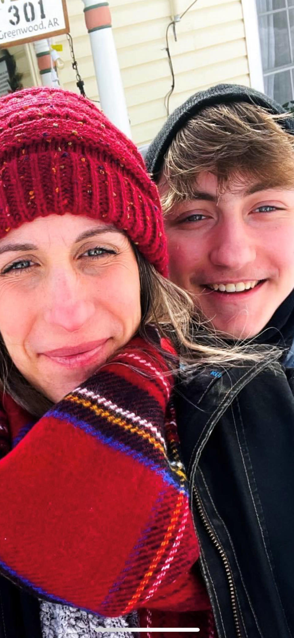 Dylan Brandt, 15, and his mom pose for a photos in Greenwood, Arkansas on Feb. 18, 2021. Dylan is one of hundreds of transgender youth in Arkansas who could have their hormone therapy cut off under a new law banning gender confirming treatments for minors. Opponents have vowed to challenge the law in court before it takes effect later this year. (Joanna Brandt via AP)