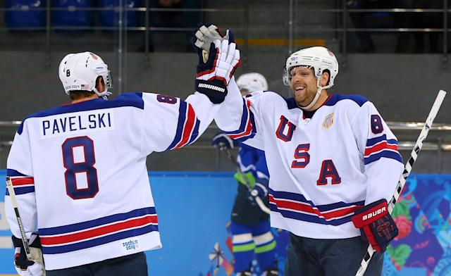 SOCHI, RUSSIA - FEBRUARY 16: Phil Kessel #81 of the United States celebrates with Joe Pavelski #8 of the United States after scoring his second goal in the first period against Slovenia, both assisted by Pavelski, during the Men's Ice Hockey Preliminary Round Group A game on day nine of the Sochi 2014 Winter Olympics at Shayba Arena on February 16, 2014 in Sochi, Russia. (Photo by Martin Rose/Getty Images)