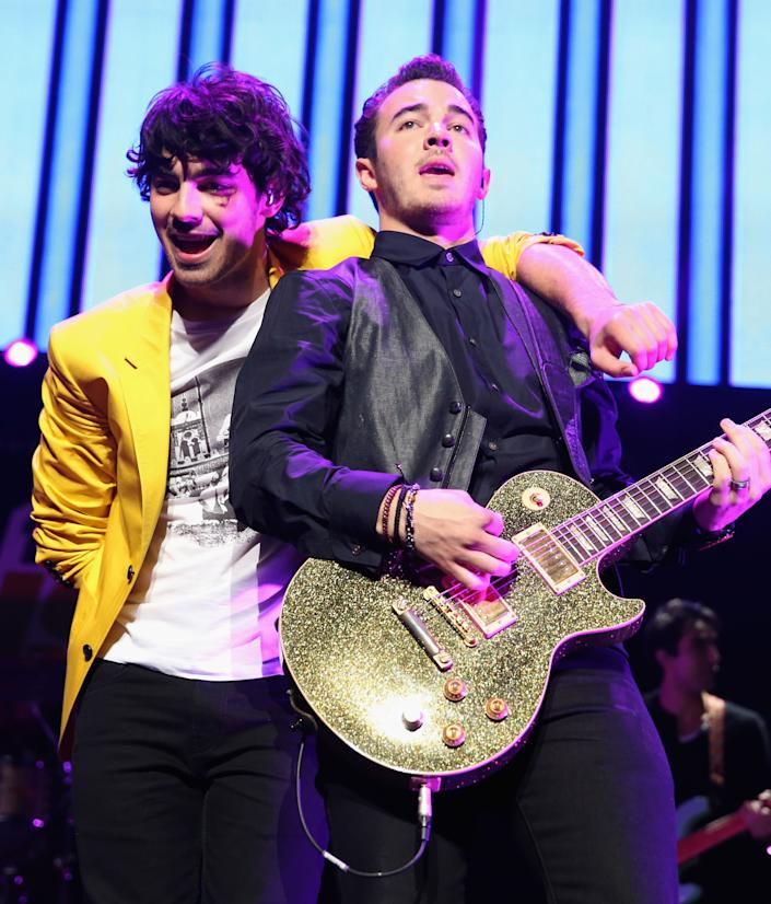 LOS ANGELES, CA - DECEMBER 01: Musicians Joe Jonas (L) and Kevin Jonas of the Jonas Brothers performs onstage during KIIS FM's 2012 Jingle Ball at Nokia Theatre L.A. Live on December 1, 2012 in Los Angeles, California. (Photo by Christopher Polk/Getty Images for Clear Channel)