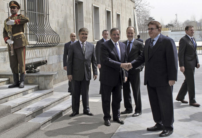 U.S. Defense Secretary Leon Panetta, center, shakes hand with his Afghan counterpart Abdul Rahim Wardak, second right in Kabul, Thursday, March 15, 2012. Afghan lawmakers expressed anger Thursday over the U.S. move to fly an American soldier accused of killing 16 civilians out of the country to Kuwait, saying Kabul shouldn't sign a strategic partnership agreement with Washington unless the suspect faces justice in Afghanistan. (AP Photo/ Mohammad Ismail, Pool)