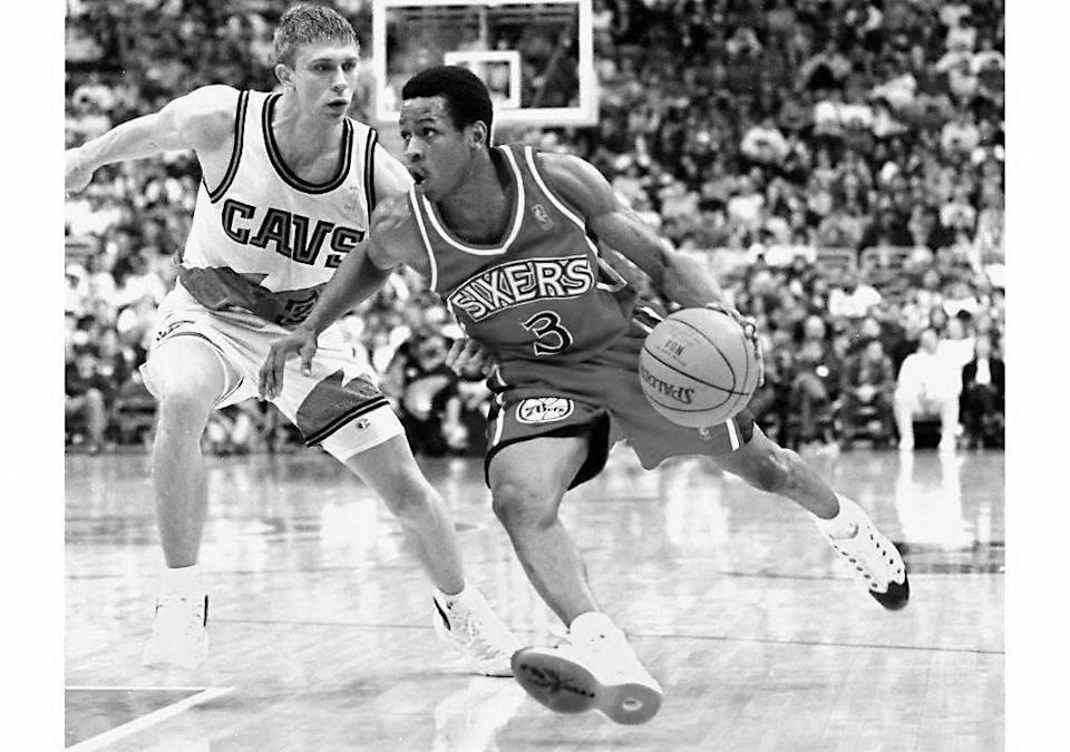 Then Philadelphia 76ers' rookie guard Allen Iverson (R) drives for the basket against Cleveland Cavaliers guard Bobby Sura (L) in game action. (KIMBERLY BARTH/AFP via Getty Images)