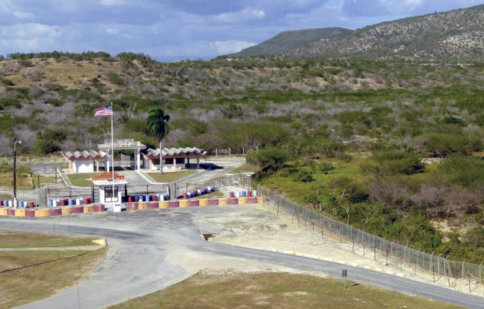 FILE - This Feb. 4, 2002, file photo show the northeast gate on the border of Cuba at the U.S. Naval Base at Guantanamo Bay, Cuba. This post at the northeast gate of the border is about 2 miles from Camp X-Ray where al-Qaida and Taliban detainees from Afghanistan were held. The White House says it intends to shutter the prison on the U.S. base in Cuba, which opened in January 2002 and where most of the 39 men still held have never been charged with a crime. (AP Photo/Lynne Sladky, File)