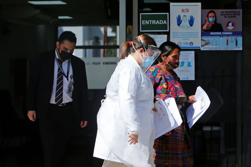 Member of Guatemalan Maya families, who feared their relatives were among 19 bodies found shot and burnt at the weekend in a remote part of northern Mexico, arrive to the Faculty of Medicine for DNA samples to help in the identification, in Guatemala City