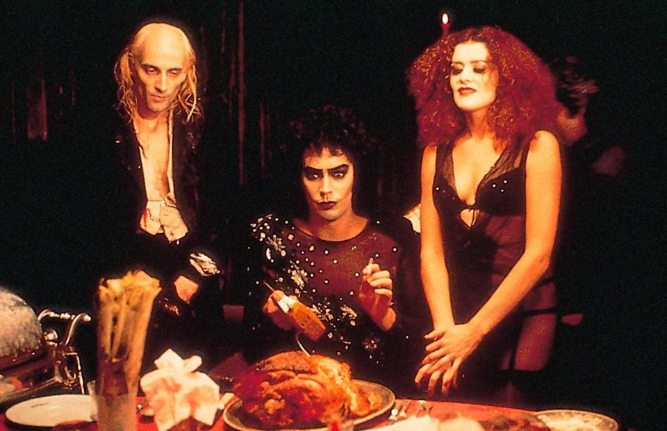 """<p>Even if you can't participate in one of the amazing theater screenings of <strong>Rocky Horror</strong>, make a date to watch the campy film in your living room. It's also pretty much a guarantee that you'll be able to find this <a class=""""link rapid-noclick-resp"""" href=""""https://www.popsugar.com/Halloween"""" rel=""""nofollow noopener"""" target=""""_blank"""" data-ylk=""""slk:Halloween"""">Halloween</a> favorite lurking somewhere on TV. </p> <p><a href=""""https://www.amazon.com/Rocky-Horror-Picture-Show/dp/B001HLZMUE"""" class=""""link rapid-noclick-resp"""" rel=""""nofollow noopener"""" target=""""_blank"""" data-ylk=""""slk:Buy or rent The Rocky Horror Picture Show on Amazon Prime here!"""">Buy or rent <b>The Rocky Horror Picture Show</b> on Amazon Prime here!</a></p>"""