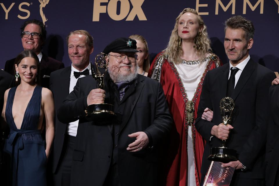 71st Primetime Emmy Awards - Photo Room – Los Angeles, California, U.S., September 22, 2019 - George R.R. Martin (C) and the cast and crew of Game of Thrones poses backstage with their award for Outstanding Drama Series. REUTERS/Monica Almeida