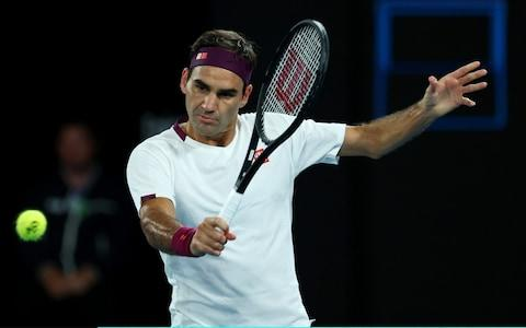 oger Federer of Switzerland plays a backhand during his Men's Singles fourth round match against Marton Fucsovics of Hungary on day seven of the 2020 Australian Open at Melbourne Park on January 26, 2020 in Melbourne, Australia