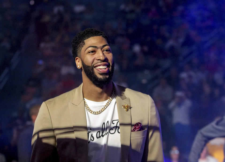 New Orleans Pelicans forward Anthony Davis (23) wears a T-shirt with 'That's All, Folks,' printed on it during player introduction before an NBA basketball game between the New Orleans Pelicans and the Golden State Warriors in New Orleans, Tuesday, April 9, 2019. (AP Photo/Scott Threlkeld)