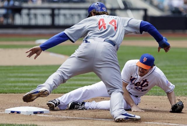 Chicago Cubs' Anthony Rizzo (44) avoids a pick-off attempt as New York Mets first baseman Daniel Murphy (28) misses the tag during the fourth inning of a baseball game Saturday, June 15, 2013, in New York. (AP Photo/Frank Franklin II)