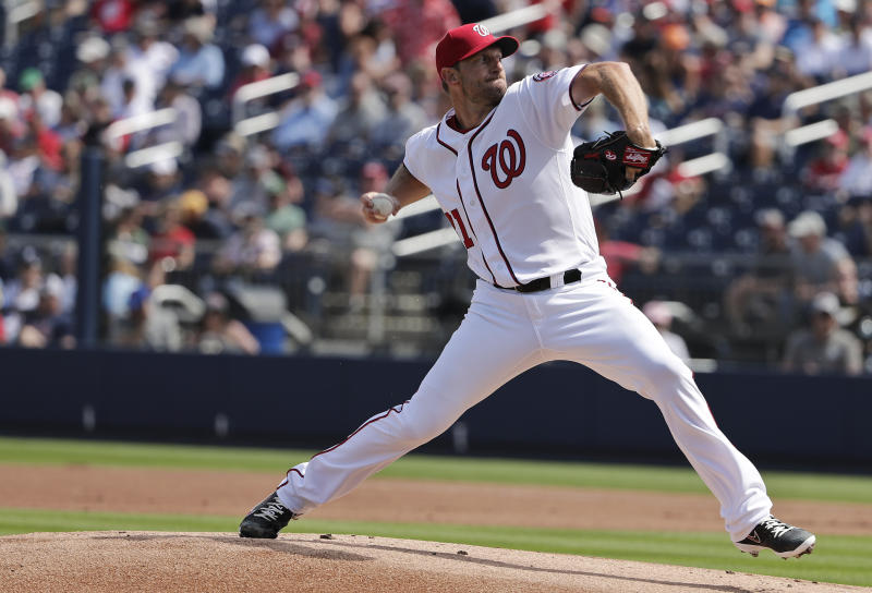 """FILE - In this March 5, 2019, file photo, Washington Nationals starting pitcher Max Scherzer throws in the first inning of an exhibition spring training baseball game against the Boston Red Sox, in West Palm Beach. As the Grapefruit League neared its conclusion, a reporter mentioned to Washington Nationals manager Dave Martinez that Max Scherzer was not precisely on schedule to start on opening day. """"We talked about it. He's going to be lined up,"""" Martinez said with a laugh. """"Come Thursday at 1:05, he'll be on the mound."""" (AP Photo/Brynn Anderson, File)"""