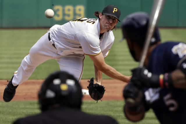Pittsburgh Pirates starting pitcher Clay Holmes delivers in the first inning of the second baseball game of a double header against the Milwaukee Brewers in Pittsburgh, Saturday, July 14, 2018. (AP Photo/Gene J. Puskar)