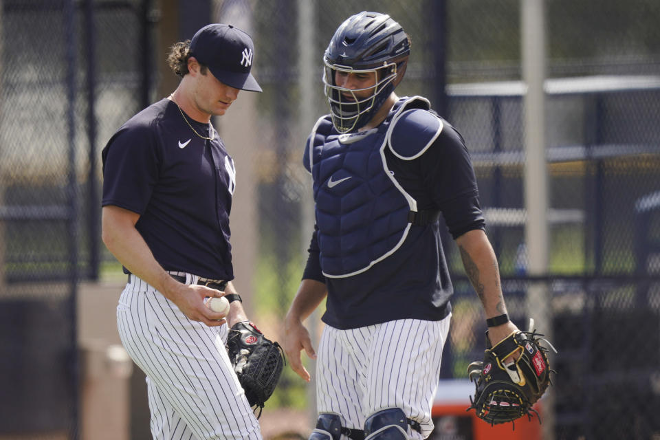 New York Yankees' Gerrit Cole, left, talks to catcher Gary Sanchez after a spring training baseball workout Monday, Feb. 22, 2021, in Tampa, Fla. (AP Photo/Frank Franklin II)