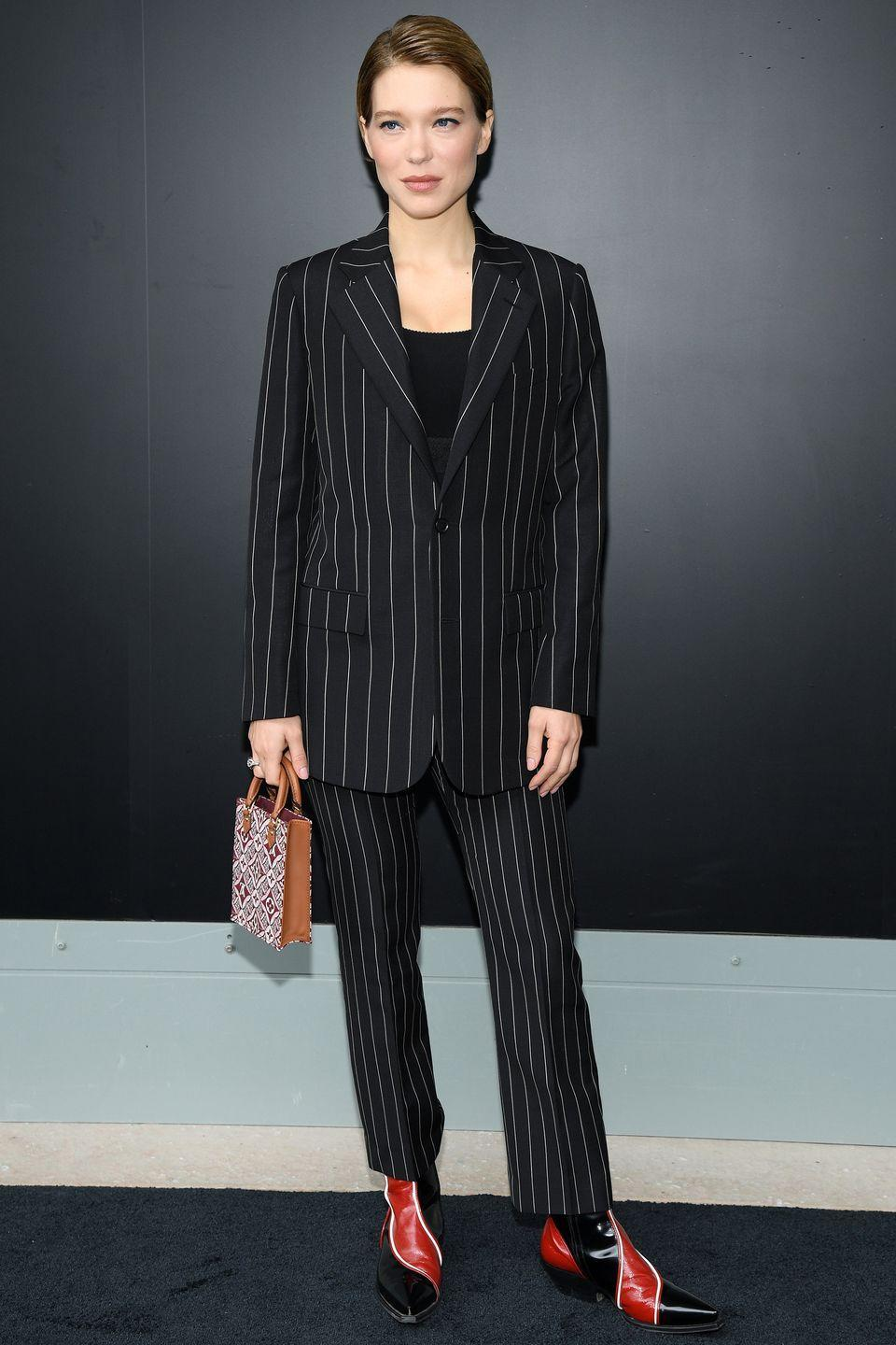 <p><strong>6 October </strong>Lea Seydoux styled a pinstripe Louis Vuitton suit with some vibrant cowboy boots. </p>