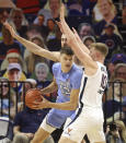 North Carolina's Walker Kessler, left, is pressured by Virginia forward Sam Hauser (10) and forward Jay Huff during an NCAA college basketball game Saturday, Feb. 13, 2021, in Charlottesville, Va. (Andrew Shurtleff/The Daily Progress via AP, Pool)