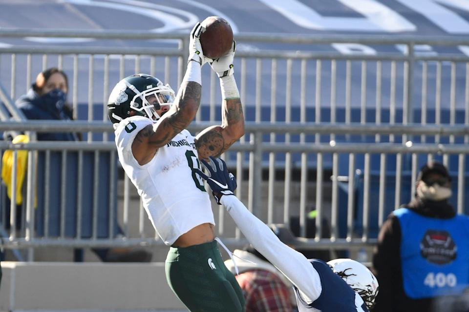 Michigan State receiver Jalen Nailor catches a touchdown pass over Penn State cornerback Marquis Wilson during the second quarter Dec. 12, 2020 in University Park, Pa.