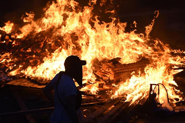 <p>Protesters have set barricades alight on July 7, 2017 in Hamburg, northern Germany. (Christof Stache/AFP/Getty Images) </p>