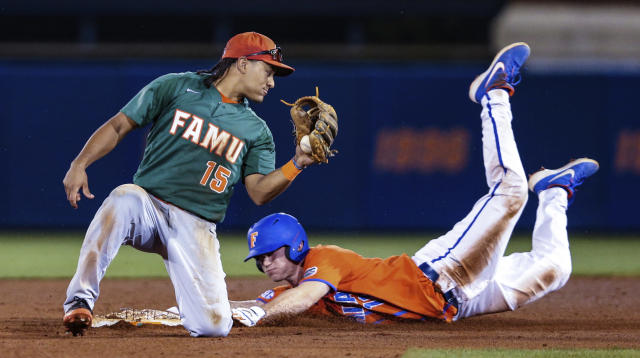 FILE - In this March 4, 2020, file photo, Florida's Brock Edge, right, steals second base, beating the tag by Florida A&M infielder Octavien Moyer (15), during the eighth inning of an NCAA college baseball game in Gainesville, Fla. The NCAA is planning on extending the eligibility of athletes on spring sports teams one year to make up for the season lost to the new coronavirus. The details of how this will work are still being ironed out. (AP Photo/Gary McCullough, File)