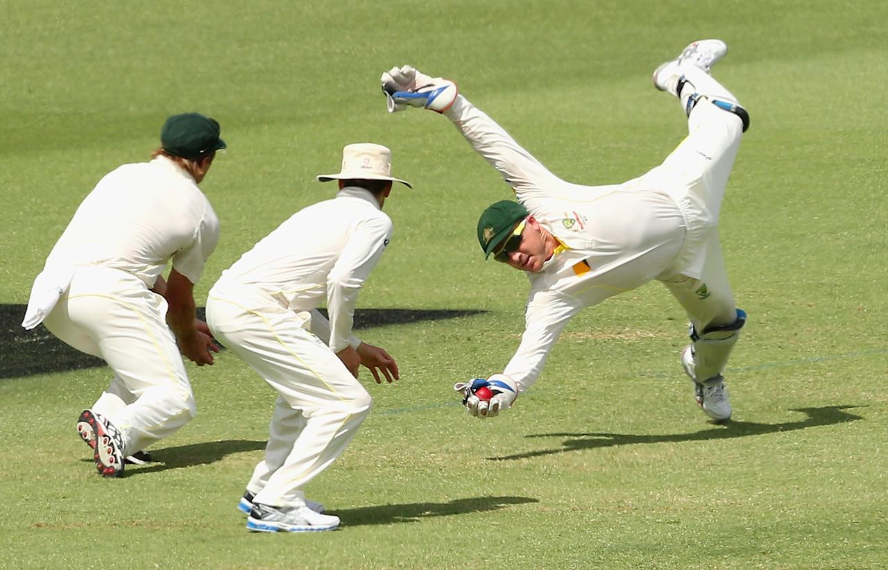 PERTH, AUSTRALIA - DECEMBER 16:  Brad Haddin of Australia takes a catch to dismiss Joe Root of England during day four of the Third Ashes Test Match between Australia and England at WACA on December 16, 2013 in Perth, Australia.  (Photo by Quinn Rooney/Getty Images)