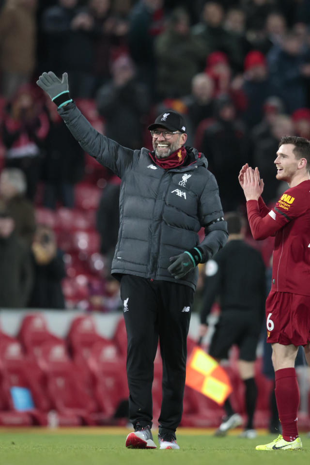 Liverpool's manager Jurgen Klopp waves to supporters after the English Premier League soccer match between Liverpool and Brighton at Anfield Stadium, Liverpool, England, Saturday, Nov. 30, 2019. (AP Photo/Jon Super)