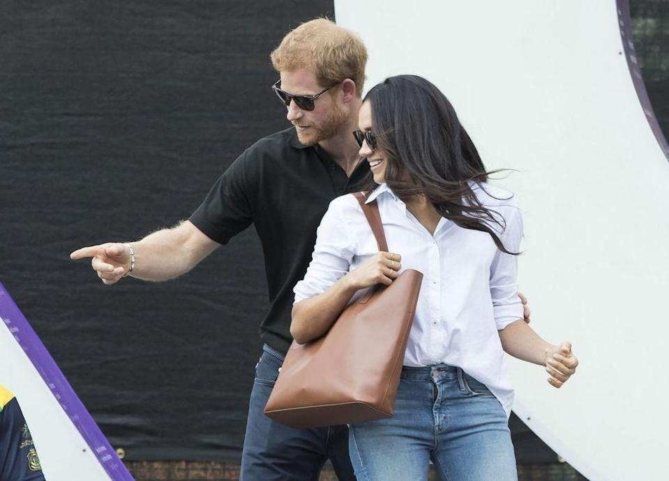 "<p>Prince Harry <a href=""https://www.townandcountrymag.com/society/tradition/a12044088/what-are-the-invictus-games-competition/"" rel=""nofollow noopener"" target=""_blank"" data-ylk=""slk:co-founded the Games"" class=""link rapid-noclick-resp"">co-founded the Games</a> back in 2014; Meghan's appearance marks the first time she's accompanied Harry at an official royal engagement.</p>"