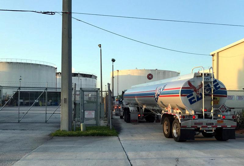 A 10,000-gallon tanker truck goes into the fuel distribution area at Port Everglades in Fort Lauderdale