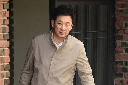 Yoo Yeong-ha, a lawyer for South Korea's ousted leader Park Geun-hye gets out of Park's private house in Seoul