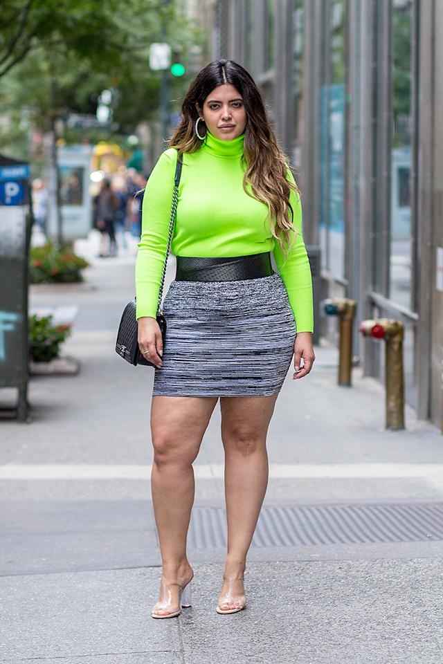 "<p><a rel=""nofollow"" href=""https://www.instagram.com/denisebidot/?hl=en"">Denise Bidot</a> wears a lime-green turtleneck sweater, black and gray mini skirt, and accessorized with a black Chanel handbag and transparent heels. (Photo: Harald Austad) </p>"
