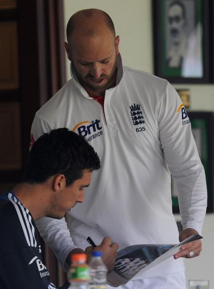 MUMBAI, INDIA - NOVEMBER 01:  Matt Prior of England (R) gets a picture signed by teammate Steve Finn during the final day of the first practice match between England and India 'A' at the CCI (Cricket Club of India) ground, on November 1, 2012 in Mumbai, India.  (Photo by Pal Pillai/Getty Images)