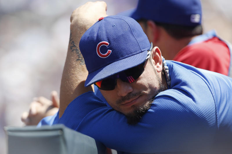 Chicago Cubs pitcher Matt Garza leans over the dugout rail in the first inning of a baseball game against the Colorado Rockie in Denver, Sunday, July 21, 2013. (AP Photo/David Zalubowski)