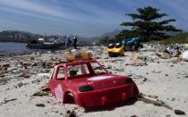 A toy is seen at Pombeba island in the Guanabara Bay in Rio de Janeiro March 12, 2014. According to the local media, the city of Rio de Janeiro continues to face criticism locally and abroad that the bodies of water it plans to use for competition in the 2016 Olympic Games are too polluted to host events. Untreated sewage and trash frequently find their way into the Atlantic waters of Copacabana Beach and Guanabara Bay - both future sites to events such as marathon swimming, sailing and triathlon events. Picture taken on March 12, 2014. REUTERS/Sergio Moraes (BRAZIL - Tags: ENVIRONMENT SPORT OLYMPICS)