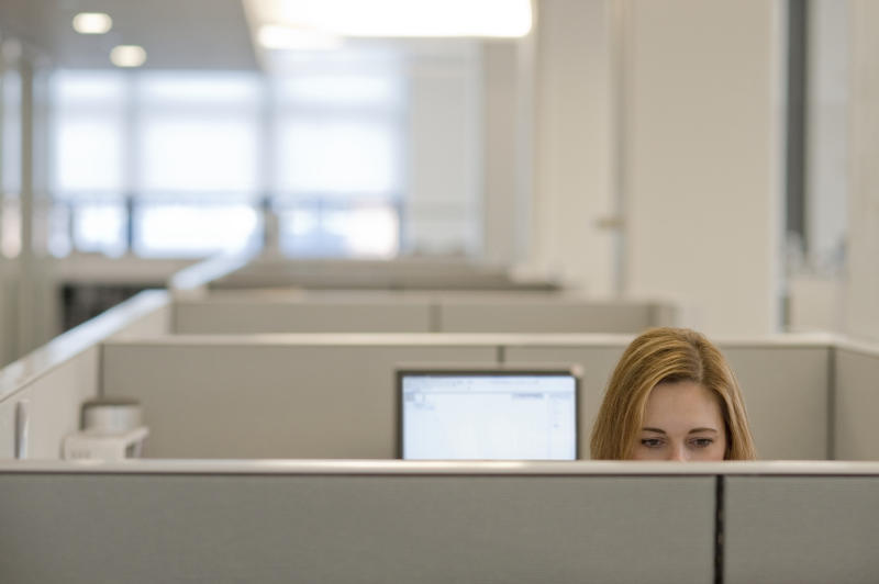 Businesswoman working in a cubicle