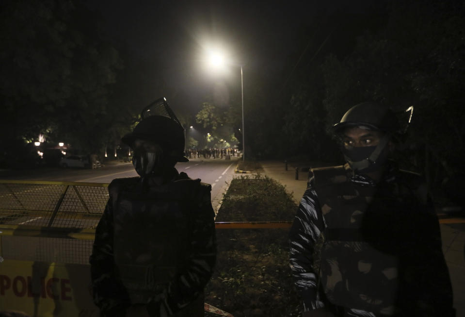 """Policemen stand guard near the Israeli Embassy after a blast in the area in New Delhi, India, Friday, Jan. 29, 2021. A """"very low intensity"""" device exploded Friday near the Israeli Embassy in the Indian capital, but there were no injuries and little damage, police said. (AP Photo/Manish Swarup)"""