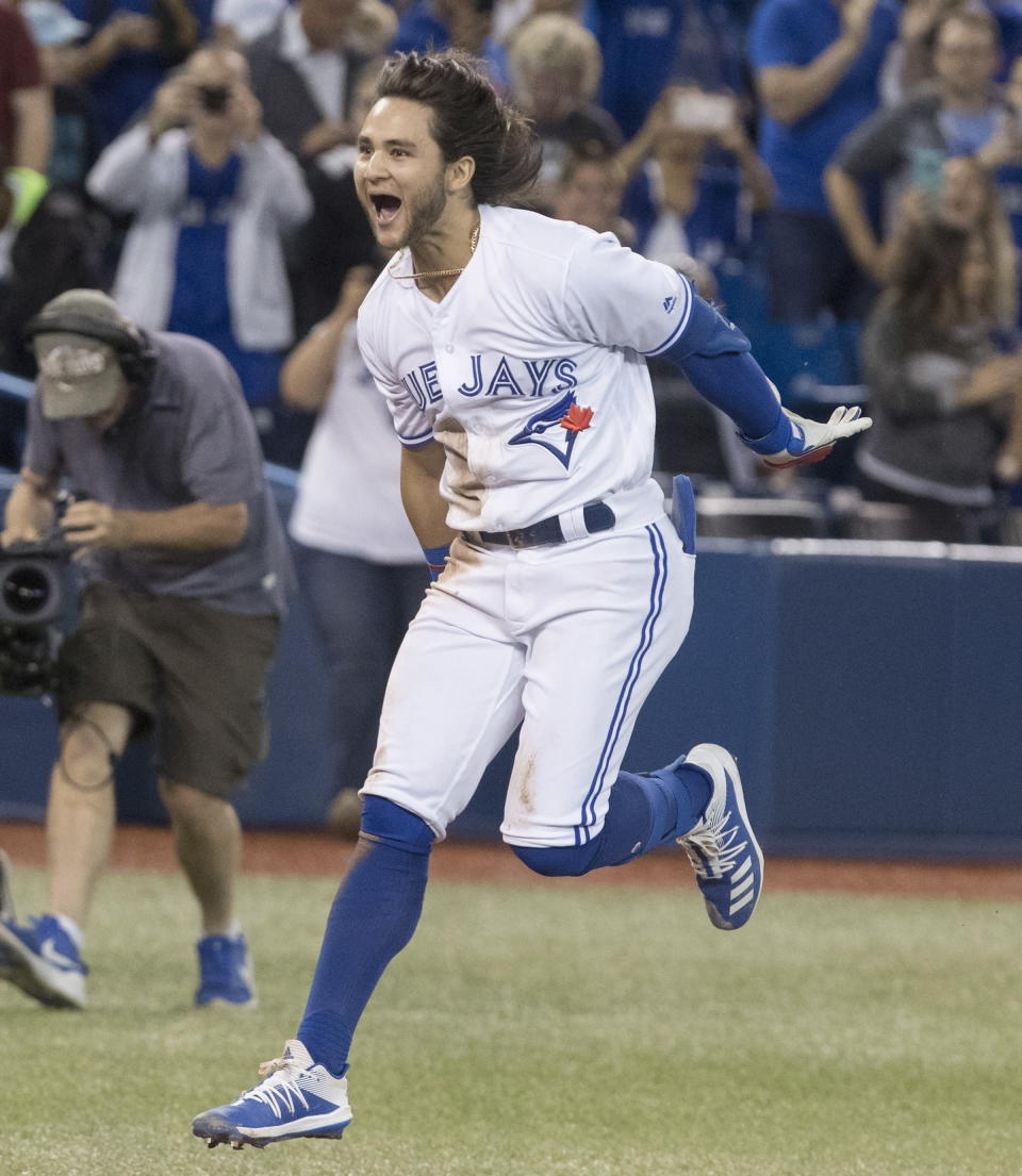 Toronto Blue Jays designated hitter Bo Bichette rounds the bases after hitting a walkoff home run to defeat the New York Yankees in the 12th inning of a baseball game in Toronto, Friday, Sept. 13, 2019. (Fred Thornhill/The Canadian Press via AP)