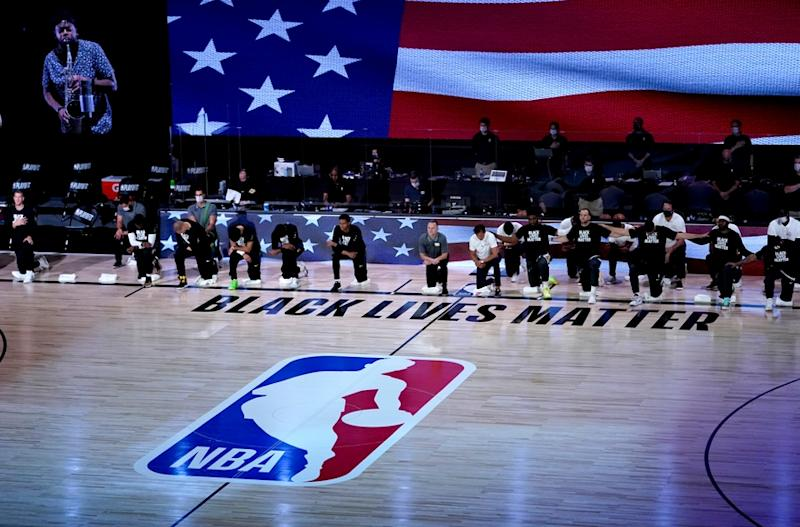 NBA players kneel during the national anthem