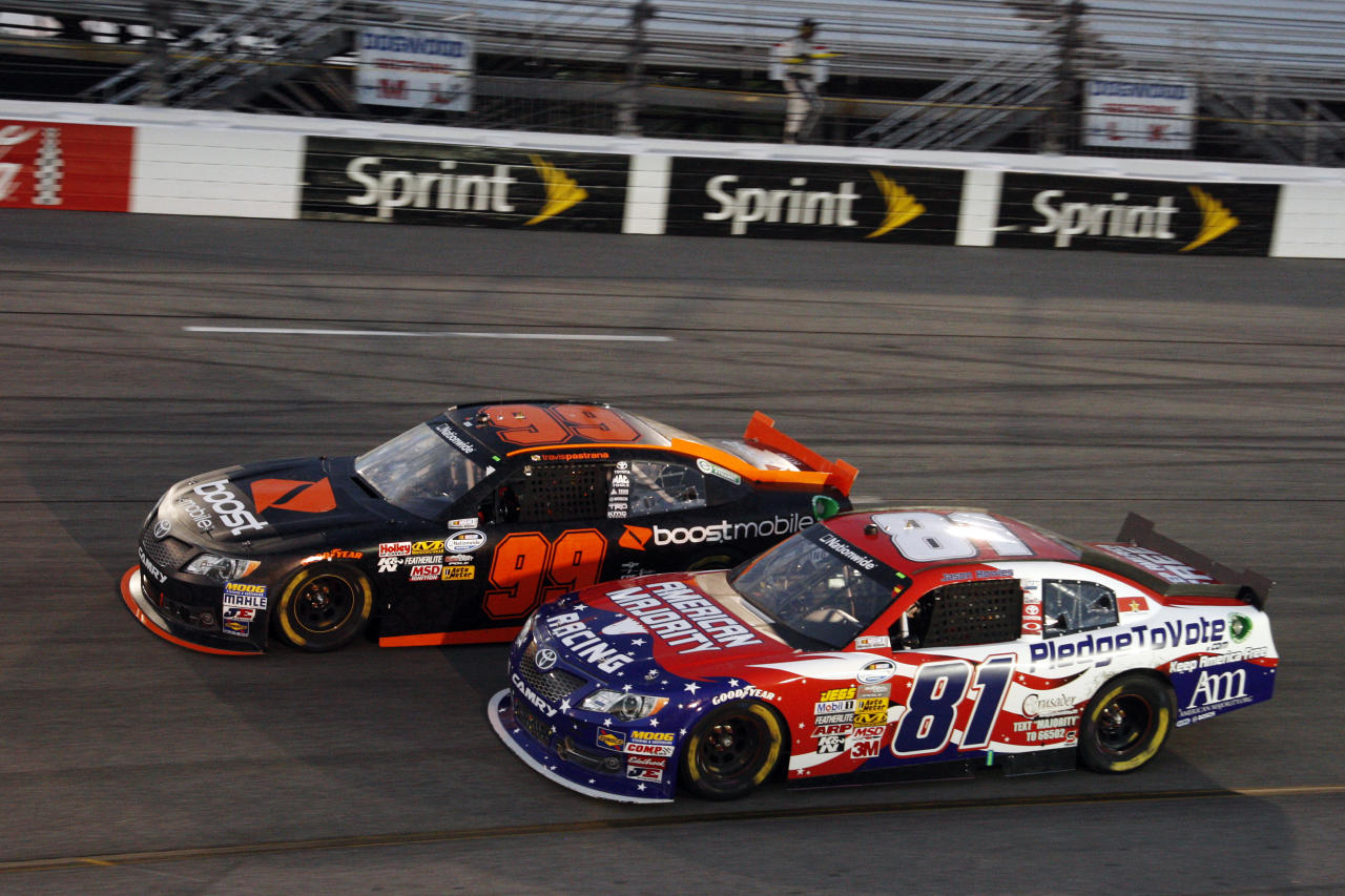 Travis Pastrana (99) passes Jason Bowles (81) during the NASCAR Nationwide Series auto race at Richmond International Raceway, Friday, April 27, 2012, in Richmond, Va. (AP Photo/LAT, Lesley Ann Miller)