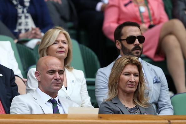 Andre Agassi and Stefanie Graf look on from the Royal Box on Centre Court during day nine of the Wimbledon Lawn Tennis Championships at the All England Lawn Tennis and Croquet Club on July 4, 2012 in London, England. (Photo by Clive Rose/Getty Images)