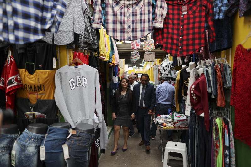 """In this Feb. 10, 2020 photo, Mayor Maria del Carmen Ortiz tours the local market in Apaseo El Alto, Guanajuato state, Mexico, following an event to inaugurate renovated sections of the market. Ortiz took office after her husband, the leading candidate to fill the office was shot to death in 2018. Between late 2019 and early 2020, her police chief, a town councilman and a police officer were shot to death.""""2018, 2019 were terrible years,"""" she concedes. (AP Photo/Rebecca Blackwell)"""