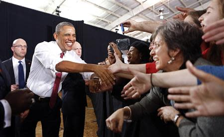U.S. President Barack Obama shakes hands as he arrives to speak during a visit to North Carolina State University in Raleigh