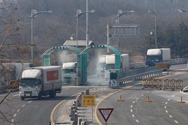 Vehicles leaving the Kaesong joint industrial zone pass through disinfectant spray before a checkpoint at the CIQ immigration centre near the Demilitarized Zone (DMZ) separating North and South Korea, in Paju on February 11, 2016 (AFP Photo/)
