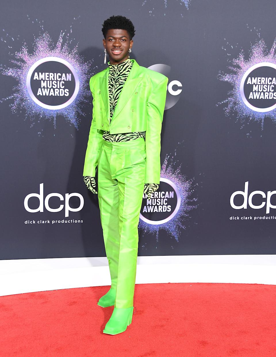This full neon green suit and zebra combo will go down as one of the best of the decade.