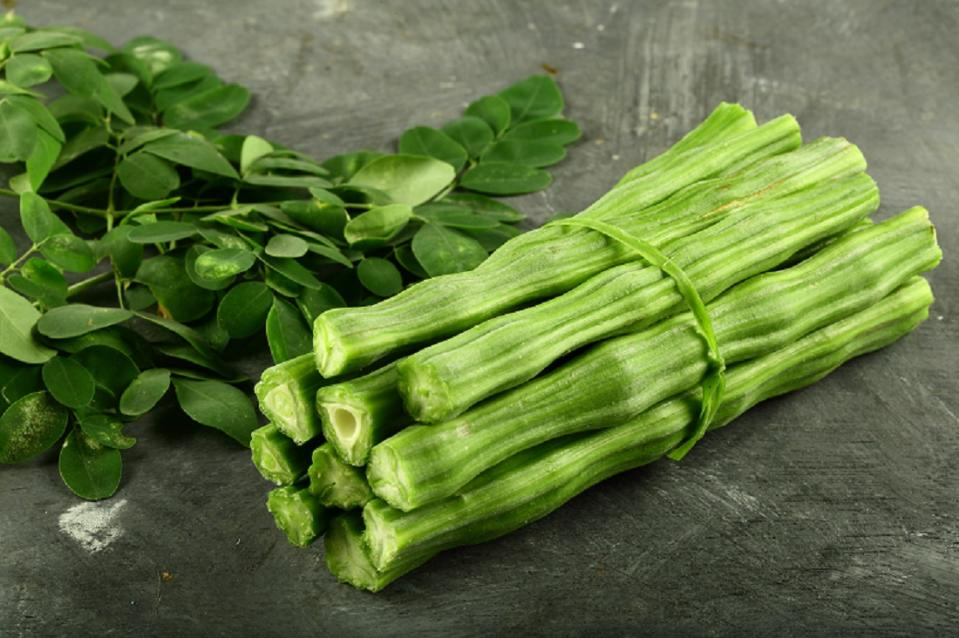 The green pods that look like sticks (hence called drumsticks) are used in many dishes like sambhar