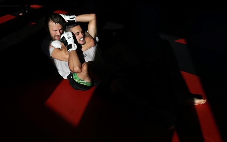 Germany's Pro MMA fighter Niklas Stolze practices a rear naked choke during a training session with Khalil El Bay in Magdeburg (AFP Photo/Ronny Hartmann)
