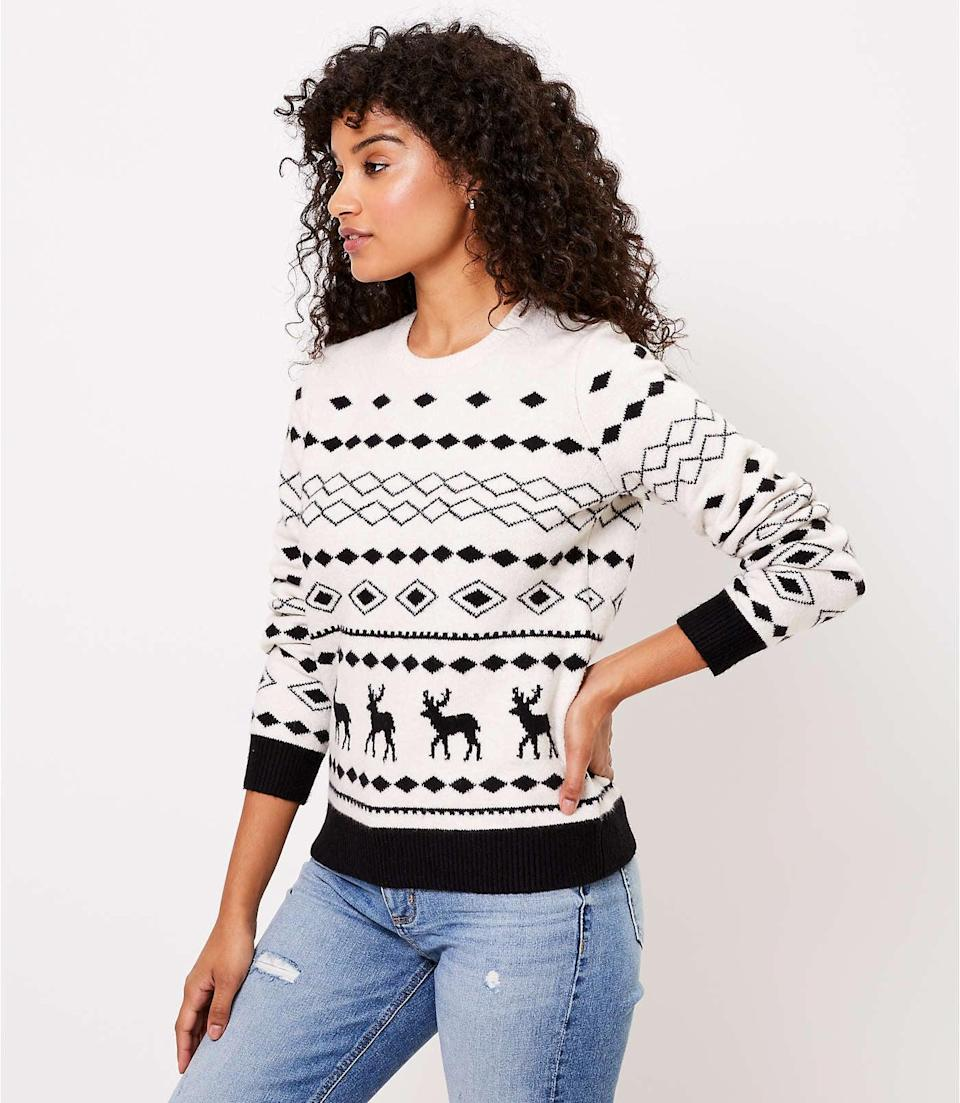<p>If you want to show off holiday spirit without going all out, this <span>Reindeer Sweater</span> ($60) is the perfect thing to wear.</p>