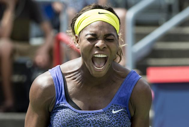 Serena Williams yells out after losing a point to her sister Venus at the Rogers Cup tennis tournament Saturday Aug. 9, 2014 in Montreal. (AP Photo/The Canadian Press, Paul Chiasson)