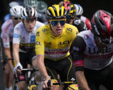 Slovenia's Tadej Pogacar, wearing the overall leader's yellow jersey, is followed by Belgium's Wout Van Aert, right, and Denmark's Jonas Vingegaard, wearing the best young rider's white jersey, as they climb during the eighteenth stage of the Tour de France cycling race over 129.7 kilometers (80.6 miles) with start in Pau and finish in Luz Ardiden, France,Thursday, July 15, 2021. (AP Photo/Christophe Ena)