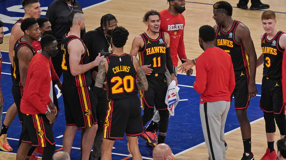 Trae Young and the Atlanta Hawks celebrate after scoring a 107-105 victory on the road against thew New York Knicks in their NBA playoff series. (Photo by Seth Wenig - Pool/Getty Images)